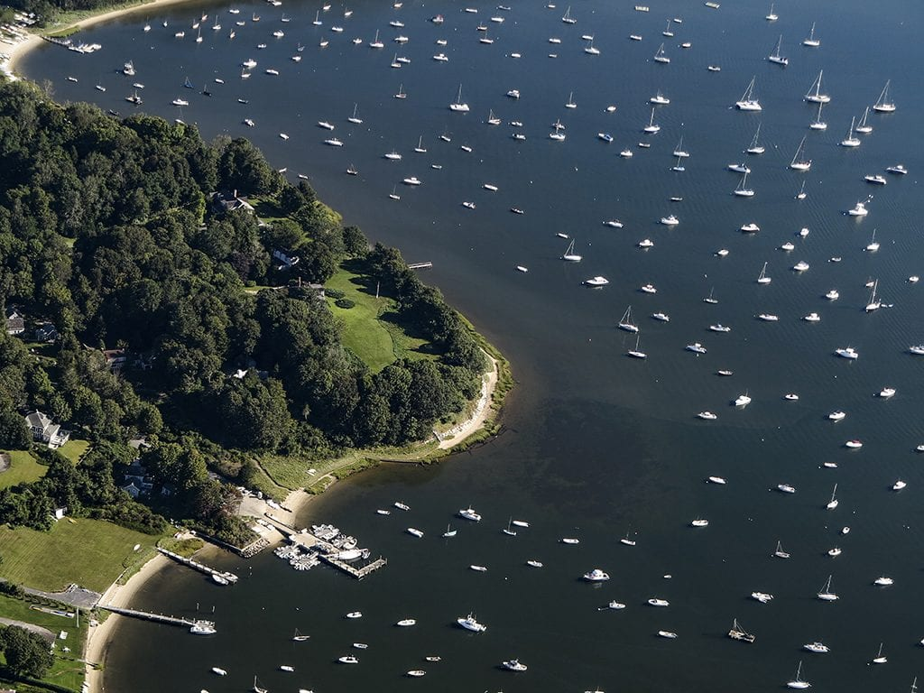 Aerial view of Cotuit Bay, including Town Dock and Proposed Site. Hundreds of boats in the bay.