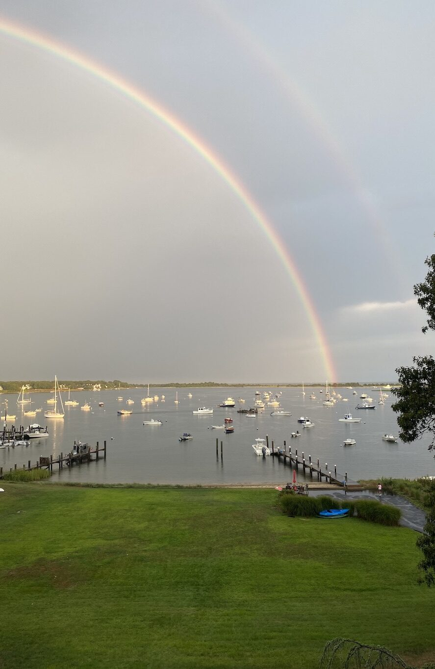 Double rainbow over Cotuit Bay. Abutting docks and Town Dock are shown, as is riprap at proposed site.